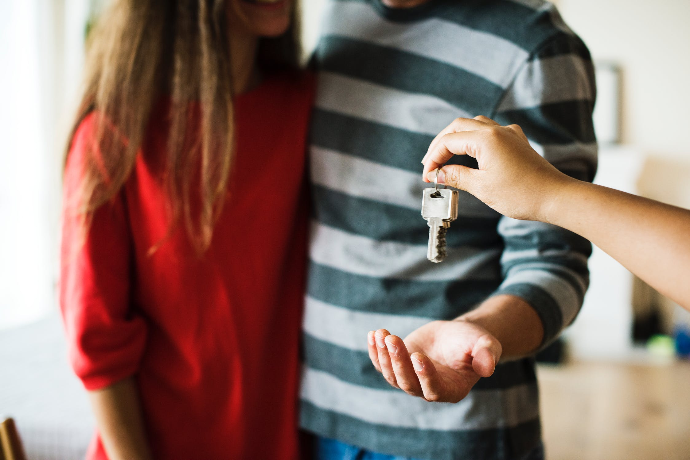Handing over keys while closing a deal on a home